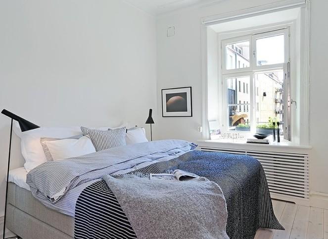 종로맛집술집 침실 인테리어 예쁜 이불이 있는 침대